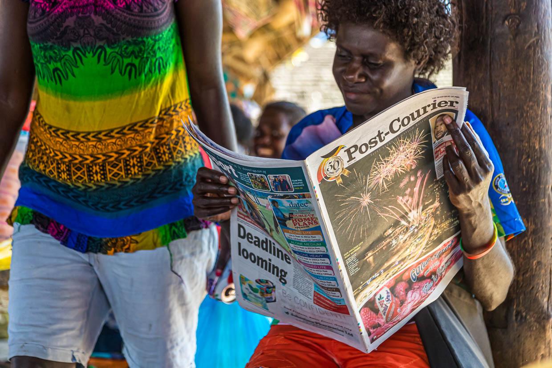 Female Newspaper-Reader in Bougainville, Papua New Guinea